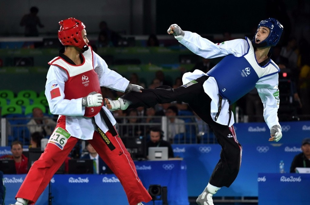 Farzan Ashourzadeh, in blue, is among the Iranian fighters scheduled to take part in the new World Taekwondo Grand Slam Champions Series in Wuxi in China ©Getty Images