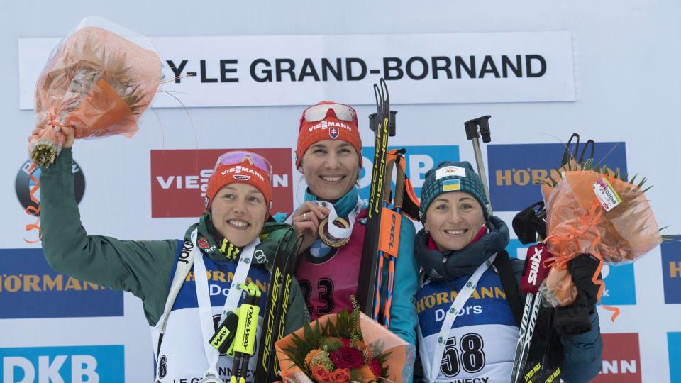 Anastasiya Kuzmina, centre, enjoyed a World Cup sprint win today ©IBU