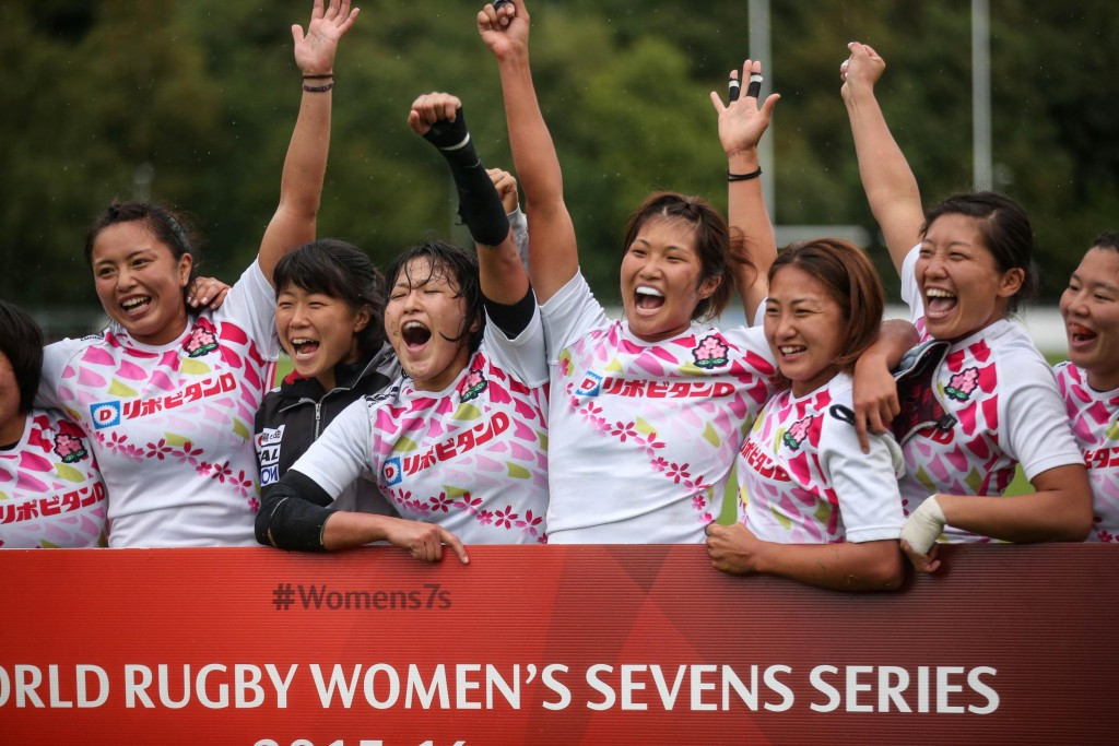 Japan's players celebrate booking their place at the HSBC World Rugby Women's Sevens Series ©INPHO/Colm O'Neill