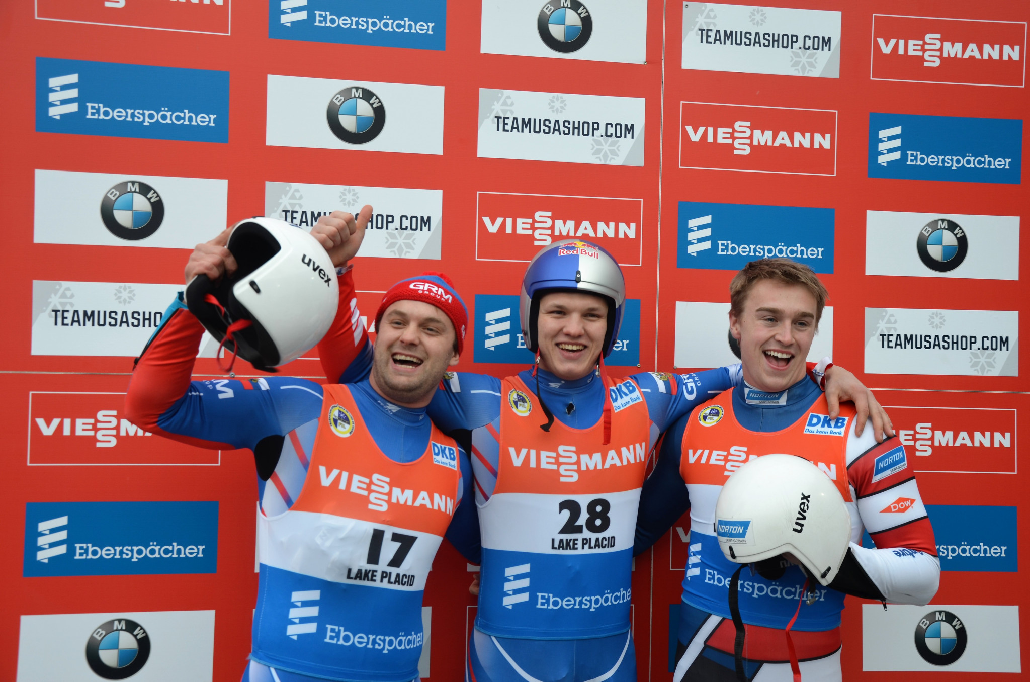 Roman Repilov, centre, recorded a record time on his way to victory in Lake Placid ©FIL