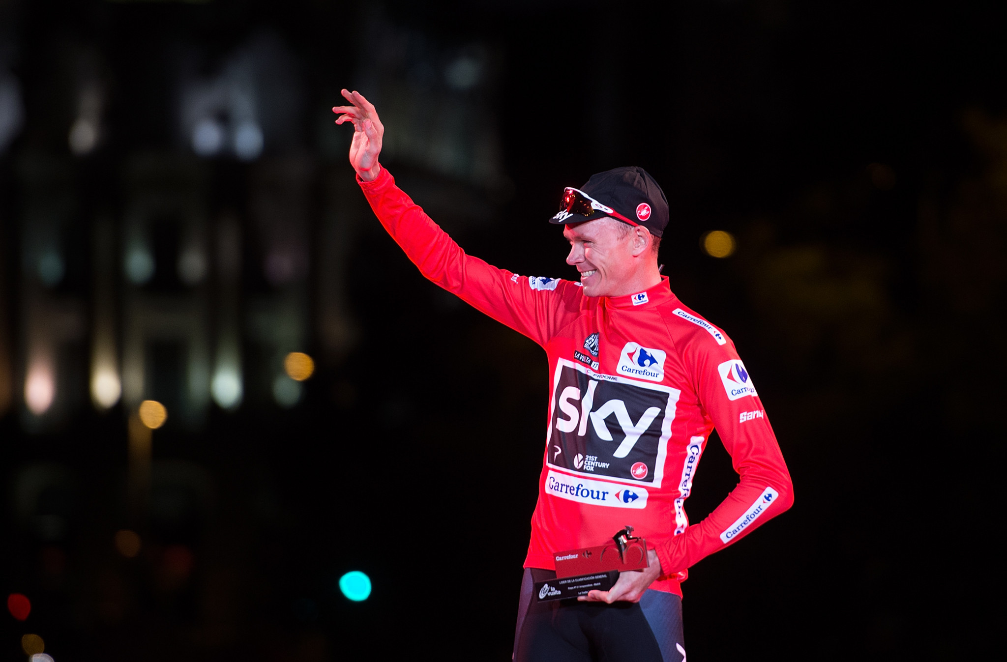 Chris Froome, wearing the Vuelta leader's red jersey, has denied all wrongdoing and has pledged to clear his name ©Getty Images