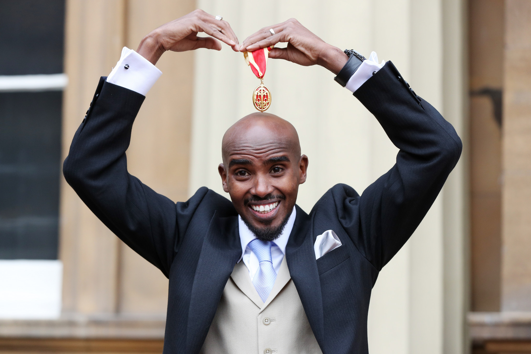Four-time Olympic champion Sir Mo Farah has had better years but nevertheless, here he does his trademark 'mobot' after receiving his knighthood from Queen Elizabeth II at Buckingham Palace last month ©Getty Images