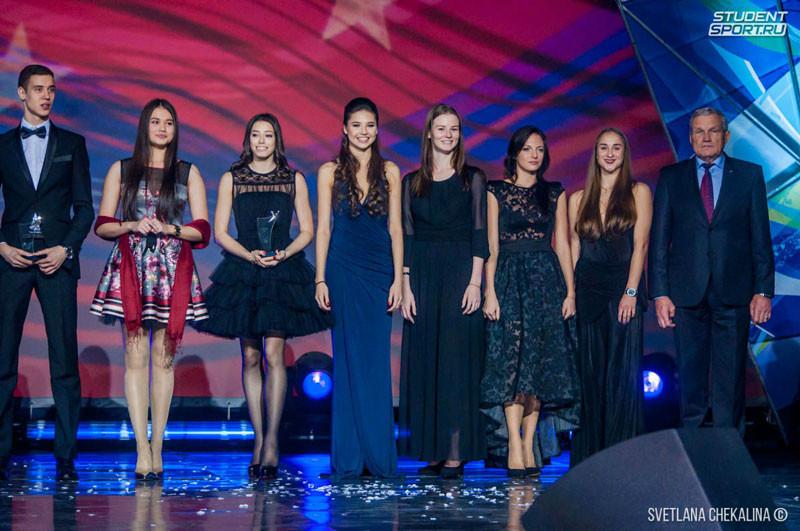 The women's rhythmic group all-around team are seen here accepting their Burevestnik award ©FISU