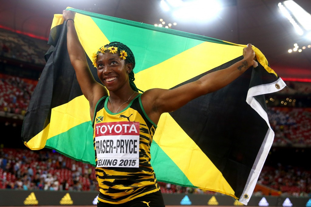 Shelly-Ann Fraser-Pryce of Jamaica celebrates after winning gold in the Women's 100 metres final during day three of the 15th IAAF World Athletics Championships  ©Getty Images