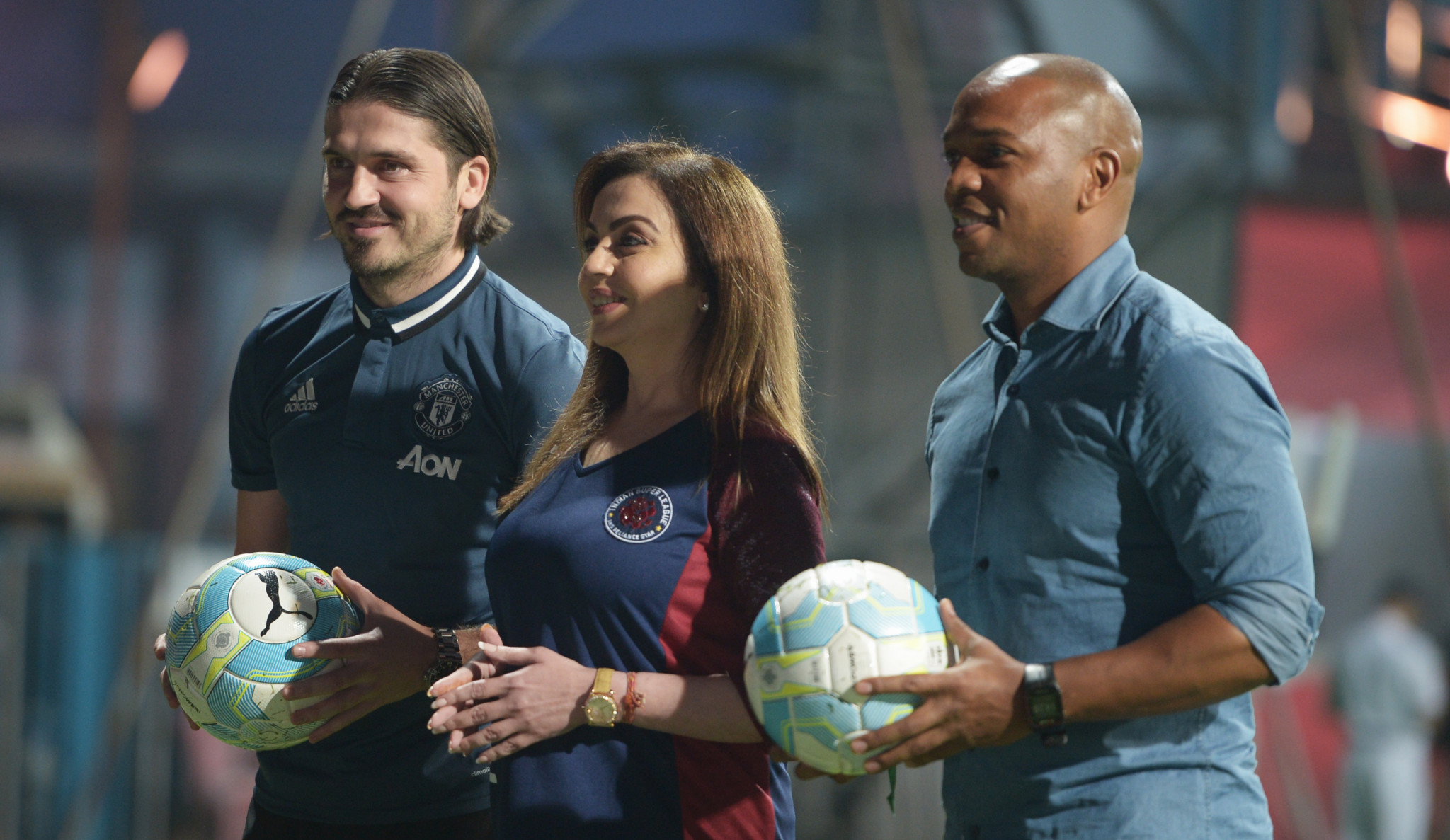 Nita Ambani, director of the Indian Super League, seen here with former Manchester United players Quinton Fortune, right,  and Bojan Djordjic, has joined the top 20 IOC members list on Twitter ©Getty Images