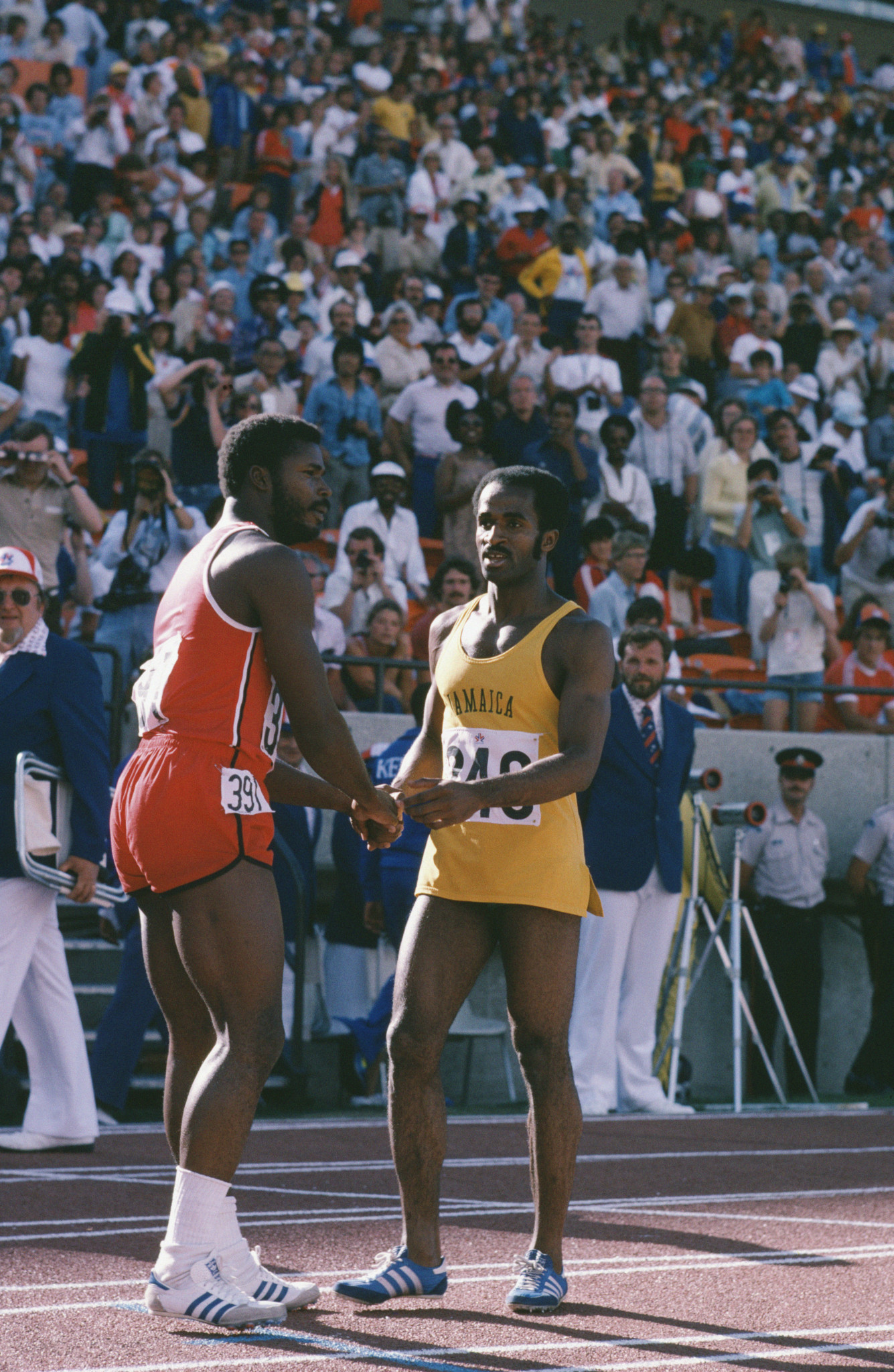 Bronze medal winner Hasely Crawford of Trinidad and Tobago congratulates Jamaican athlete Don Quarrie, right, on winning the gold in the 100 Metres at the Commonwealth Games in Edmonton, Canada, in August 1978. Allan Wells, of Scotland, finished second ©Getty Images