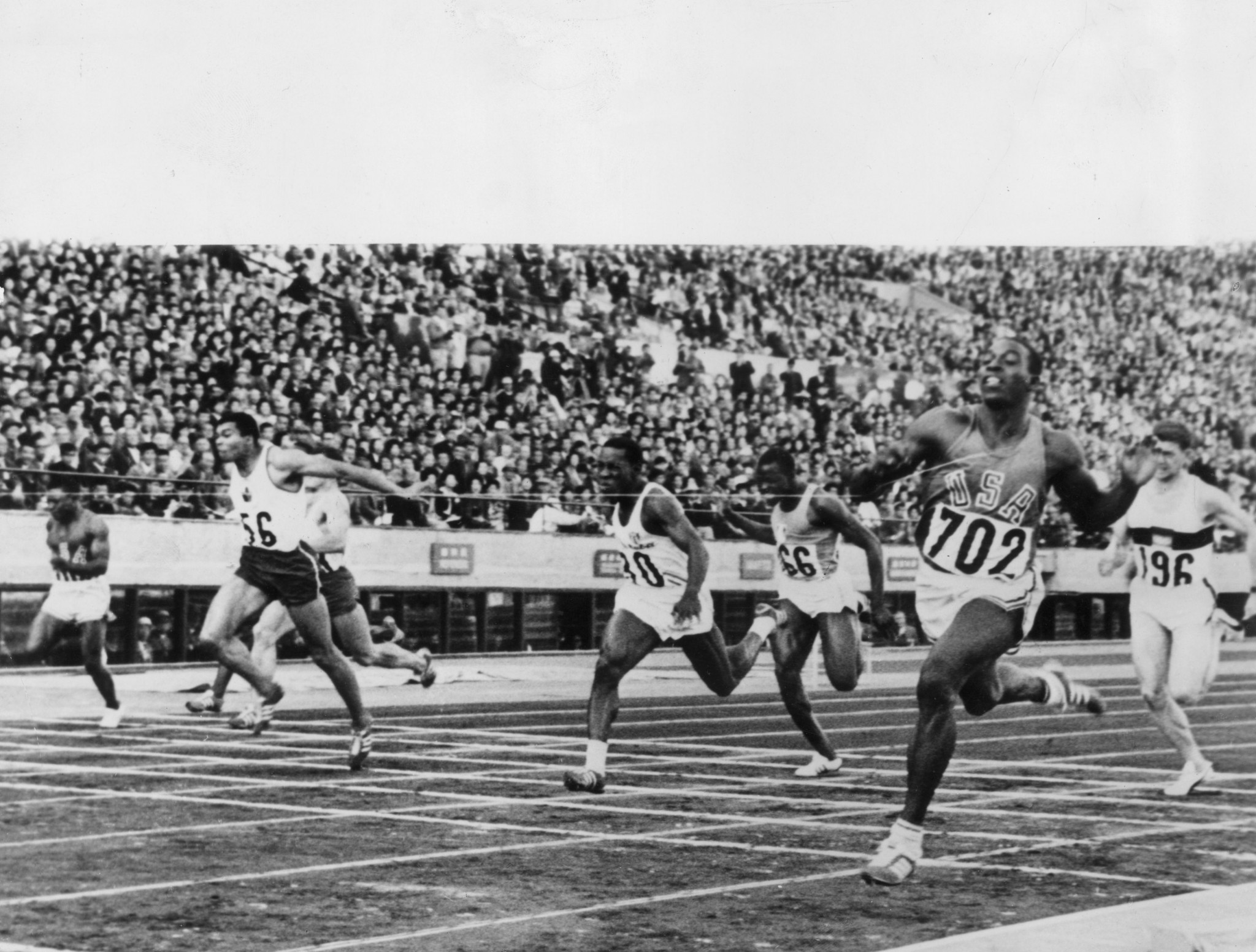 The Baton passed a statue in honour of Canadian sprinter Harry Jerome, seen here at the Tokyo Olympics, numbered 56, finishing third behind Robert Hayes, of the USA, and Enrique Figuerola Camue, of Cuba ©Getty Images