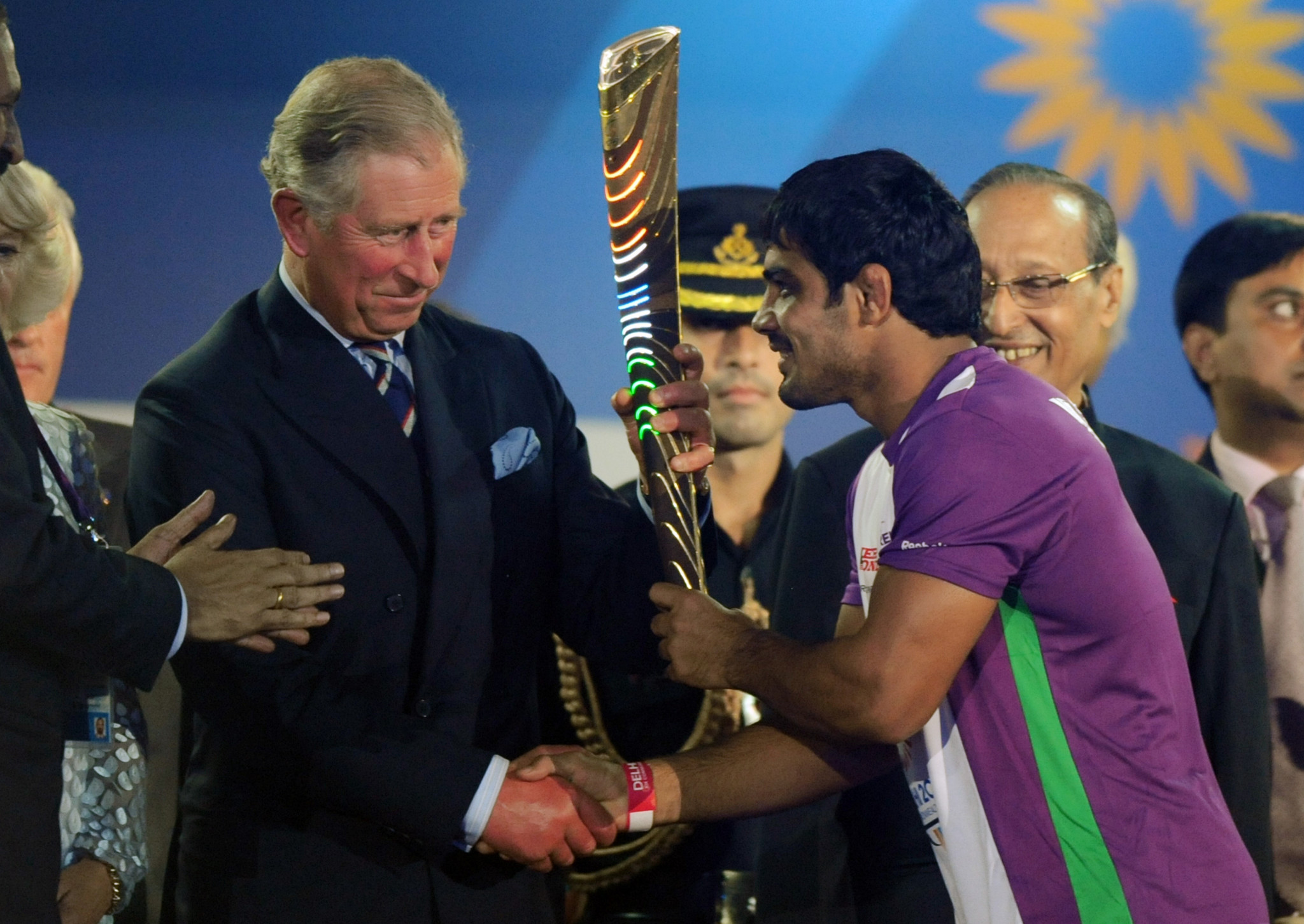 Prince Charles, the Prince of Wales, receives the Queen's Baton from Indian wrestler Sushil Kumar at the XIX Commonwealth Games opening ceremony in New Delhi in 2010. The Prince will again play a leading role in Gold Coast ©Getty Images
