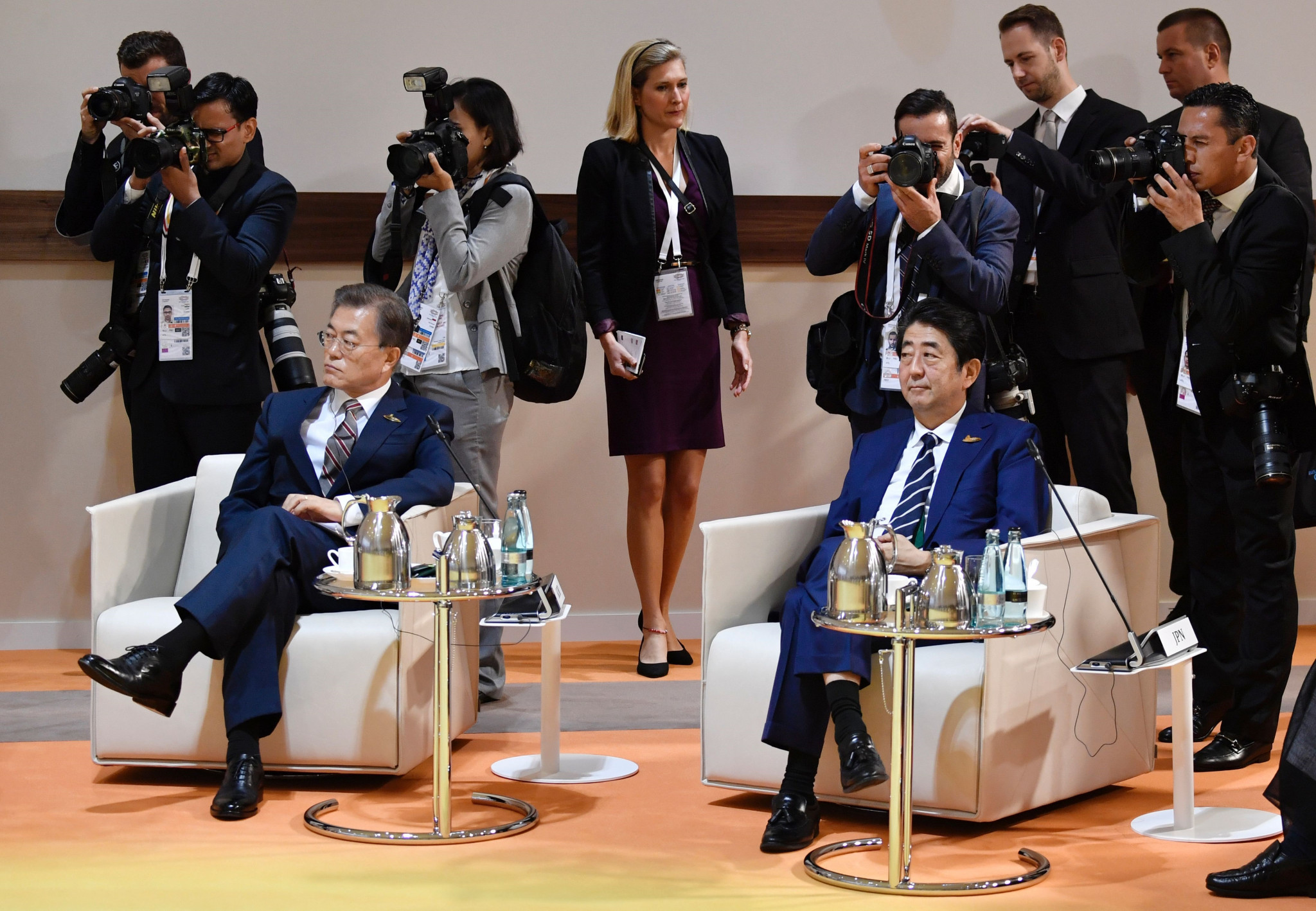 The administration of South Korea President Moon Jae-in, left, invited Shinzō Abe, right, to attend the Pyeongchang 2018 Opening Ceremony ©Getty Images