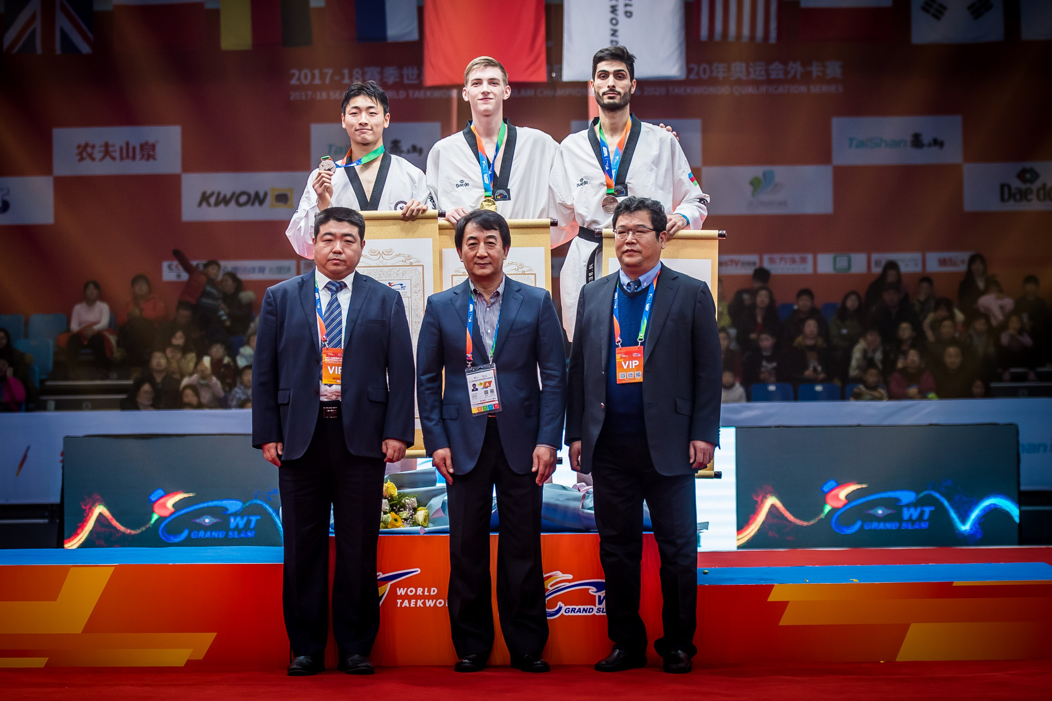 Azerbaijan's reigning world champion Milad Beigi Harchegani, back right, completed the top three ©World Taekwondo
