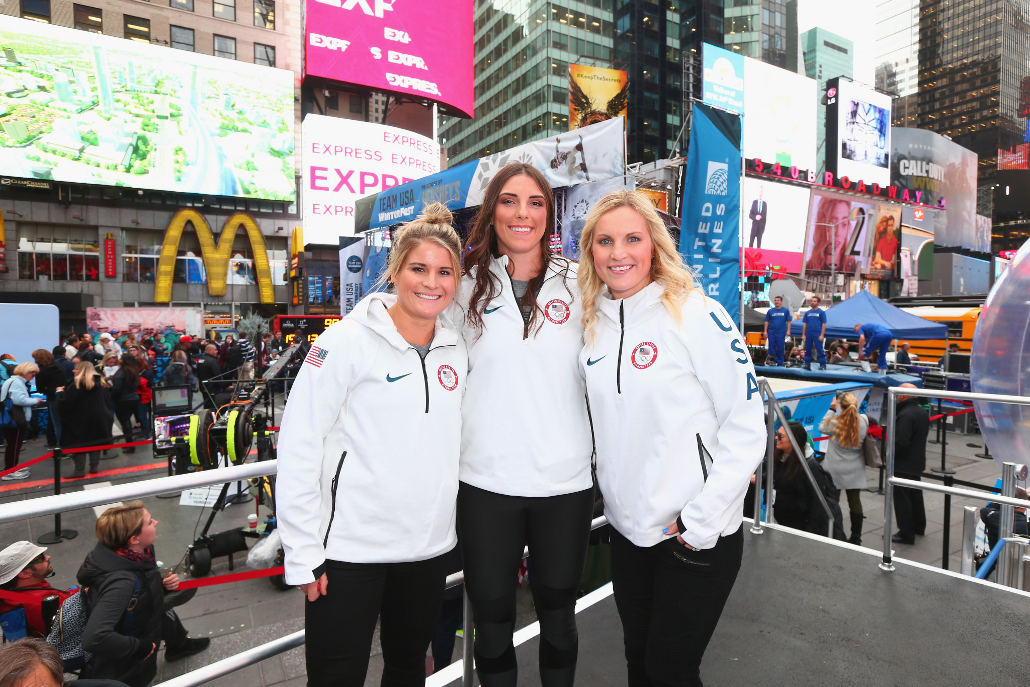 Team USA's women's ice hockey players Brianna Decker, Hilary Knight and Jocelyne Lamoureux-Davidson attend the 100 Days Out 2018 PyeongChang Winter Olympics Celebration in Times Square, New York City ©Getty Images