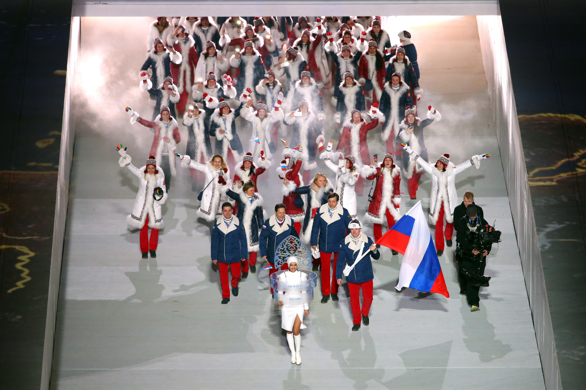 Alexander Zubkov, who has since been disqualified for doping, pictured carrying the Russian flag at the Opening Ceremony of Sochi 2014 ©Getty Images
