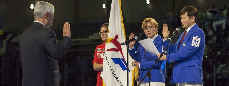 canada's Barbara Marian, centre, taking the referee oath at the Opening Ceremony of the 2016 World Junior Taekwondo Championships in Burnaby in her home country ©Taekwondo Canada