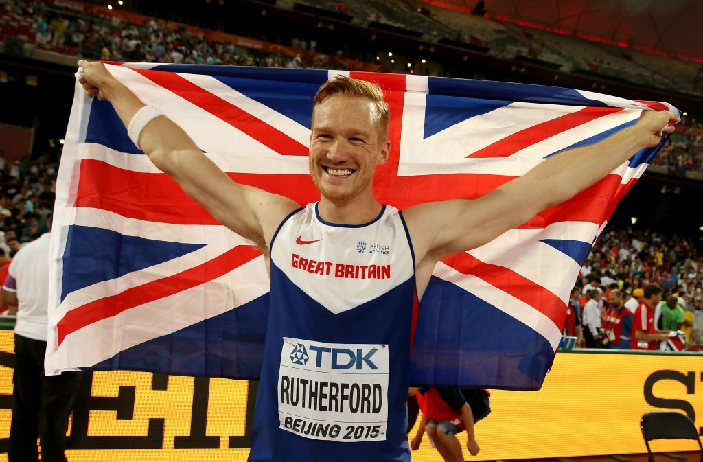 Greg Rutherford completes his medal set in Beijing - and even has a Union flag behnd him, if not on his chest ©Getty Images