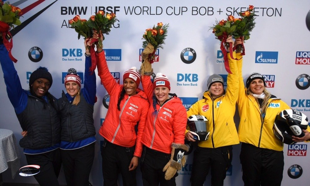 Kaillie Humphries and Phylicia George, centre, celebrate their victory today ©IBSF