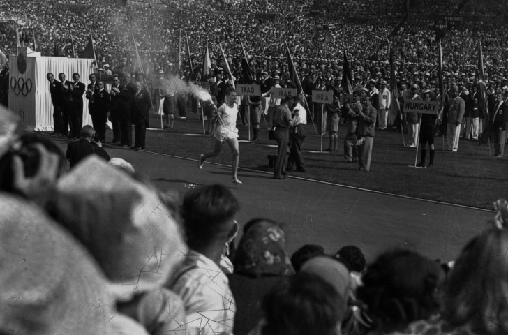 The teams line up as the Olympic Torch is borne towards the cauldron at the 1948 London Games - but there was no place for Germany, Japan or the Soviet Union... ©Getty Images