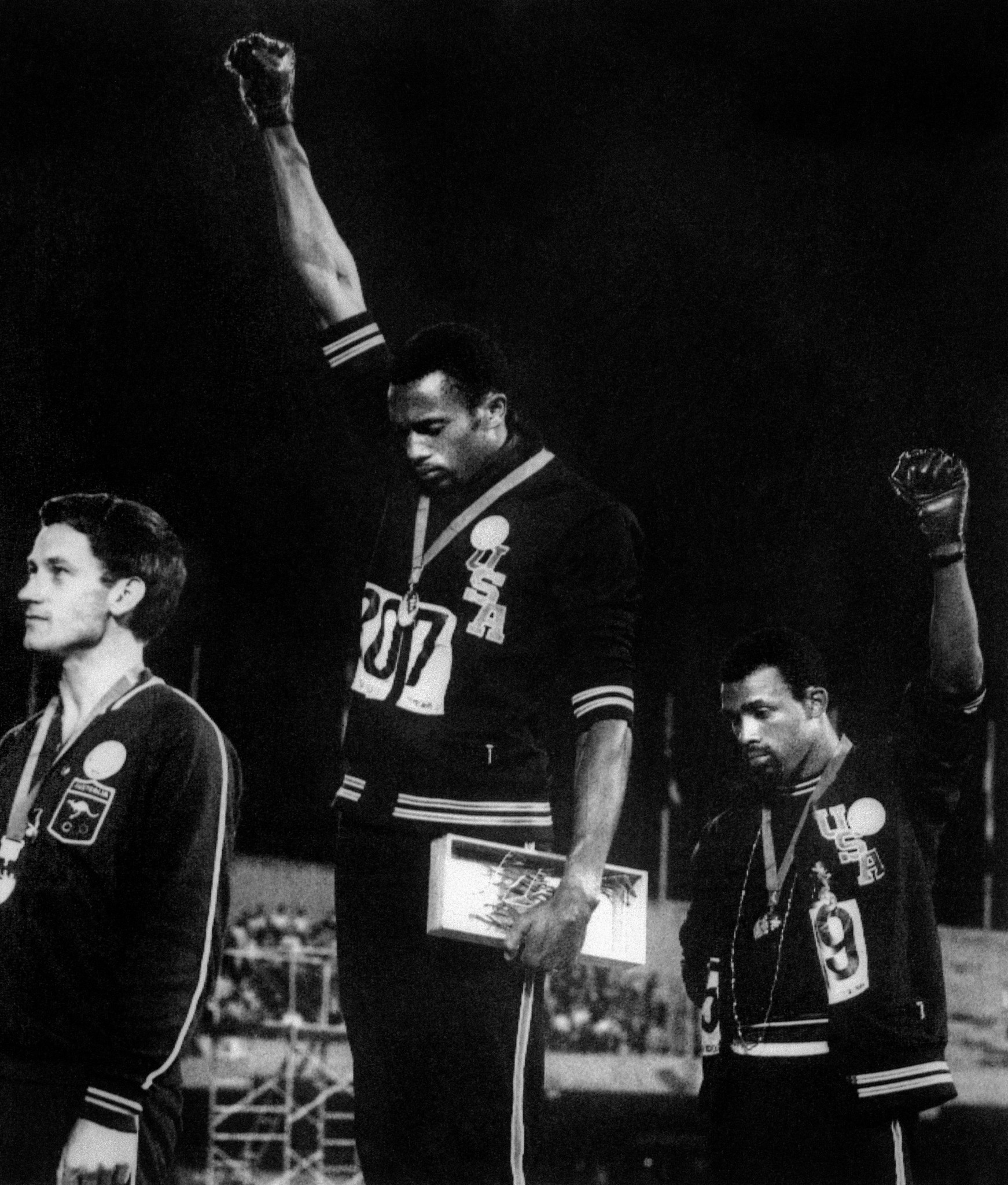 Tommie Smith, centre, and John Carlos, right, make their Black Power salutes at the medal ceremony for the 200m at the 1968 Mexico Games ©Getty Images