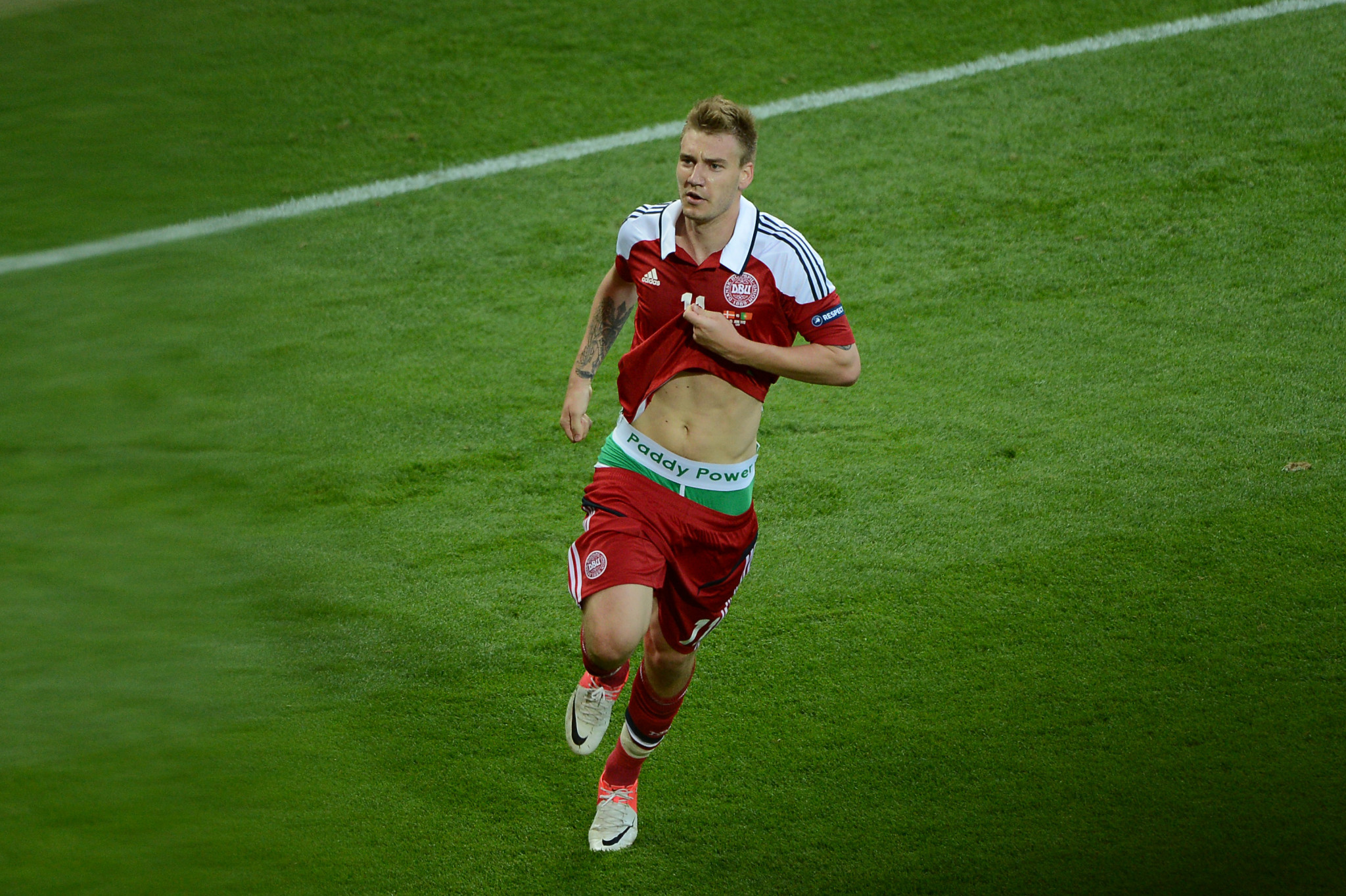 Denmark's Nicklas Bendtner was given a one match ban after exposing underpants promoting a sponsor ©Getty Images