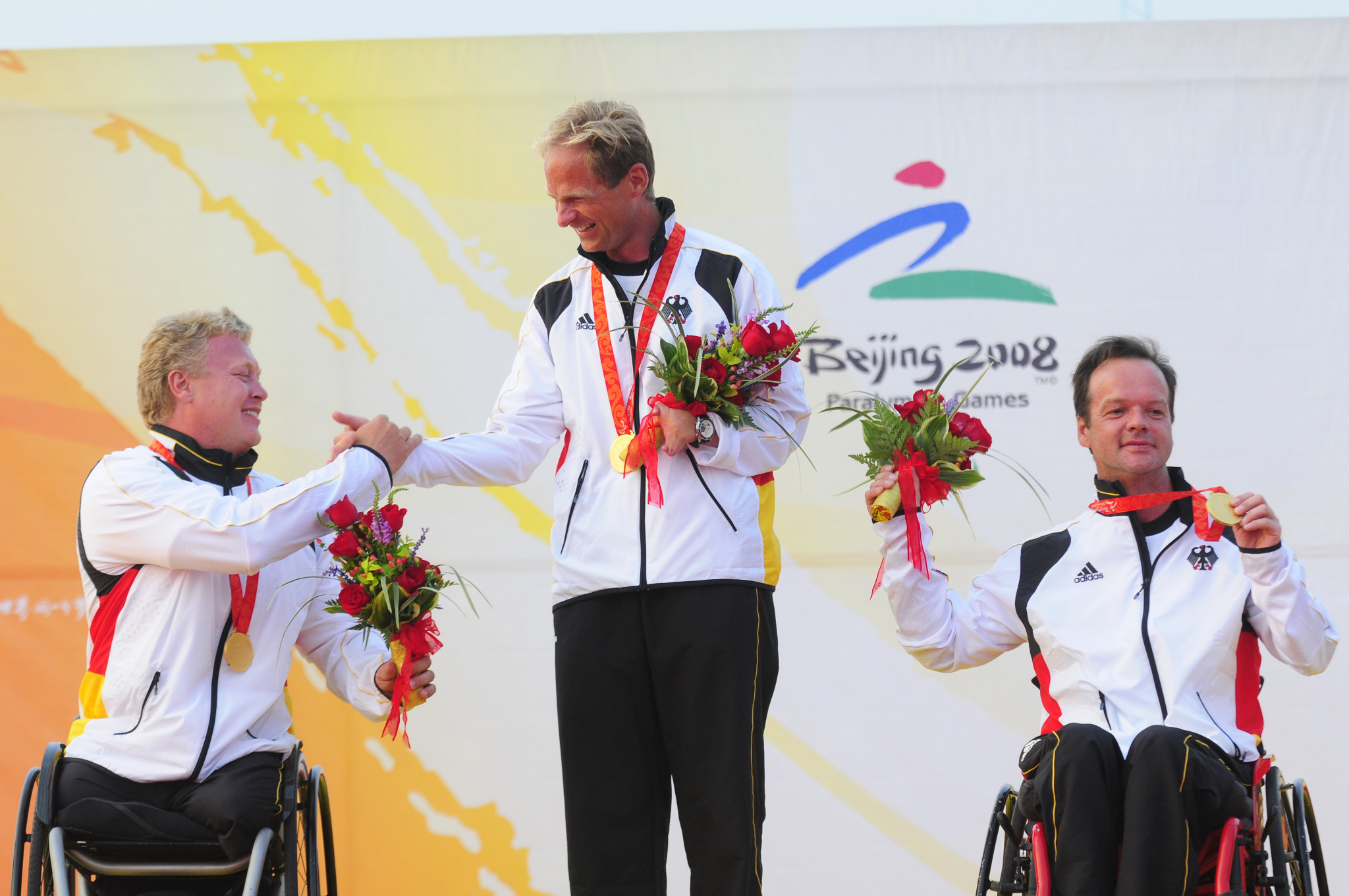 Jens Kroker, centre, won three Paralympic medals including gold in Beijing ©Getty Images