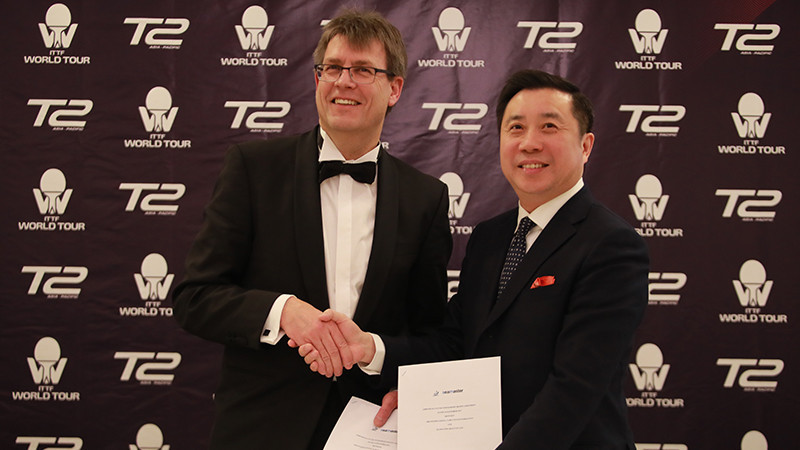 Thomas Weikert, left, and Frank Ji, have signed a collaboration agreement between the ITTF and T2 ©ITTF