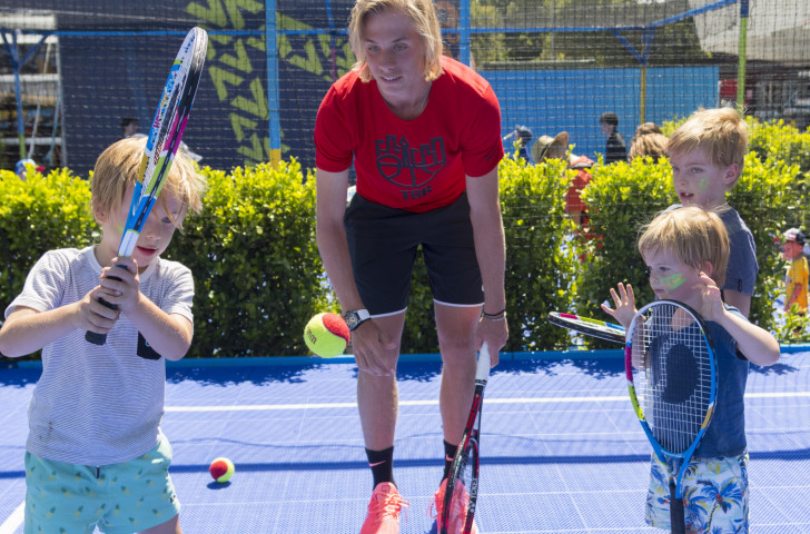 Canada's Denis Shapovalov playing tennis with children in the AO BallPark activities zone at the Australian Open, where learning and enjoyment are higher on the agenda than the desire to smash the opposition...©Getty Images