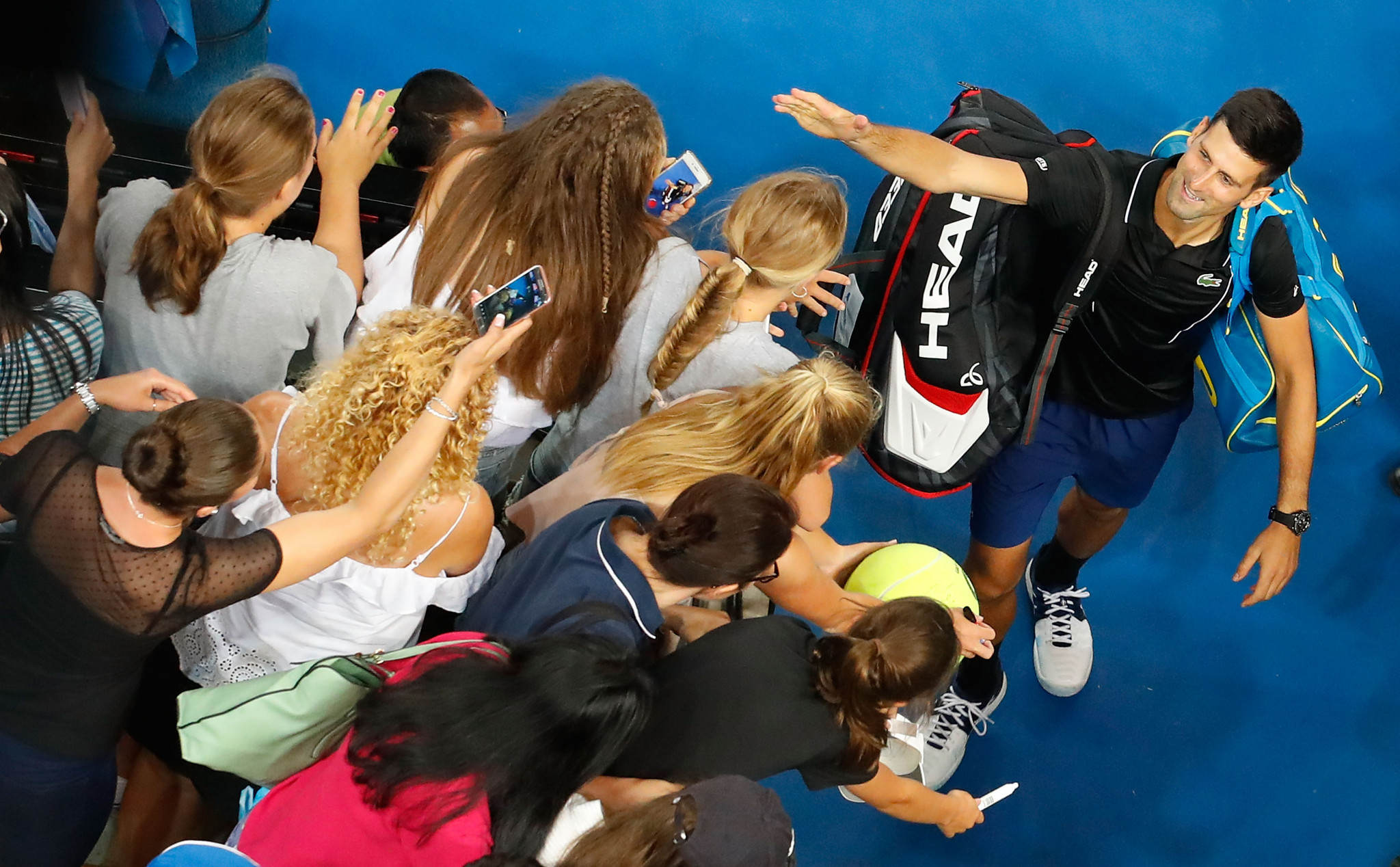 Novak Djokovic celebrates with supporters after his win today ©Getty Images