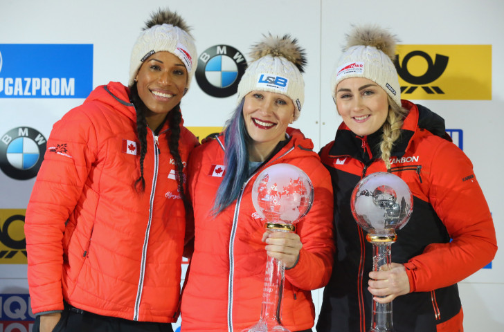 Kaillie Humphries, centre, and Phylicia George, left celebrate another overall women's bobsleigh  World Cup victory in Königssee, a performance that will be a boost for Pyeongchang 2018 ©Getty Images