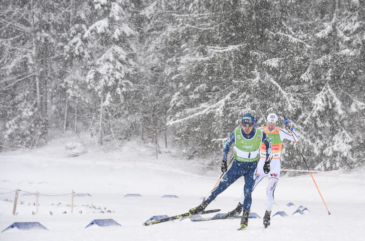 Norway's Jan Schmid tracks the winner of the jumping section, Japan's Akito Watabe, before passing him in the final stages to claim a fourth FIS Nordic Combined World Cup win in Chaux-Neuve ©Getty Images