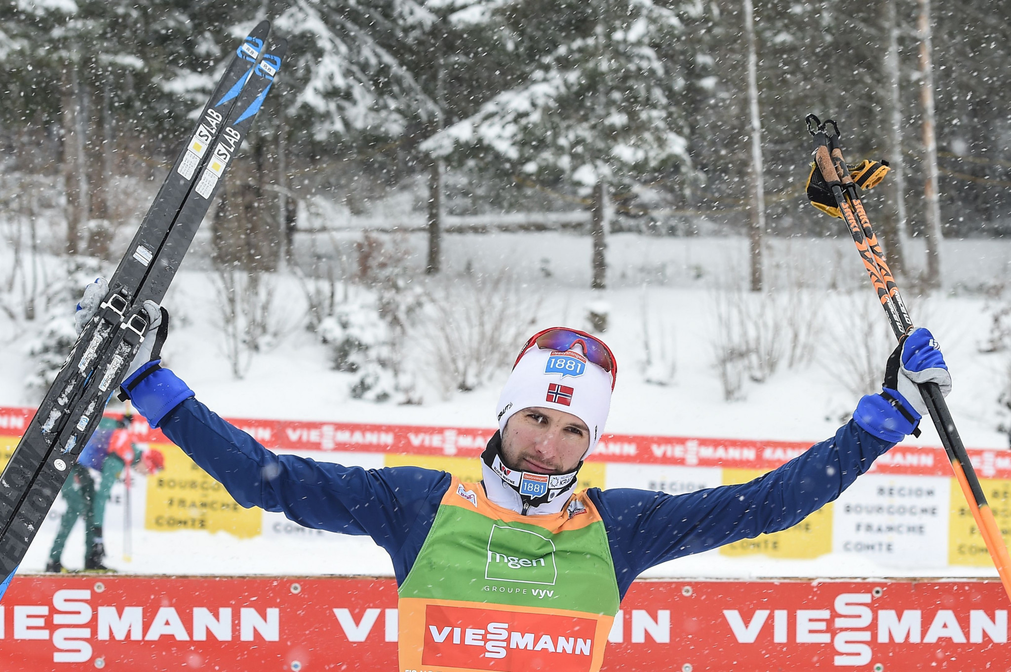 Schmid shows nerve in the blizzard to win fourth FIS Nordic Combined World Cup