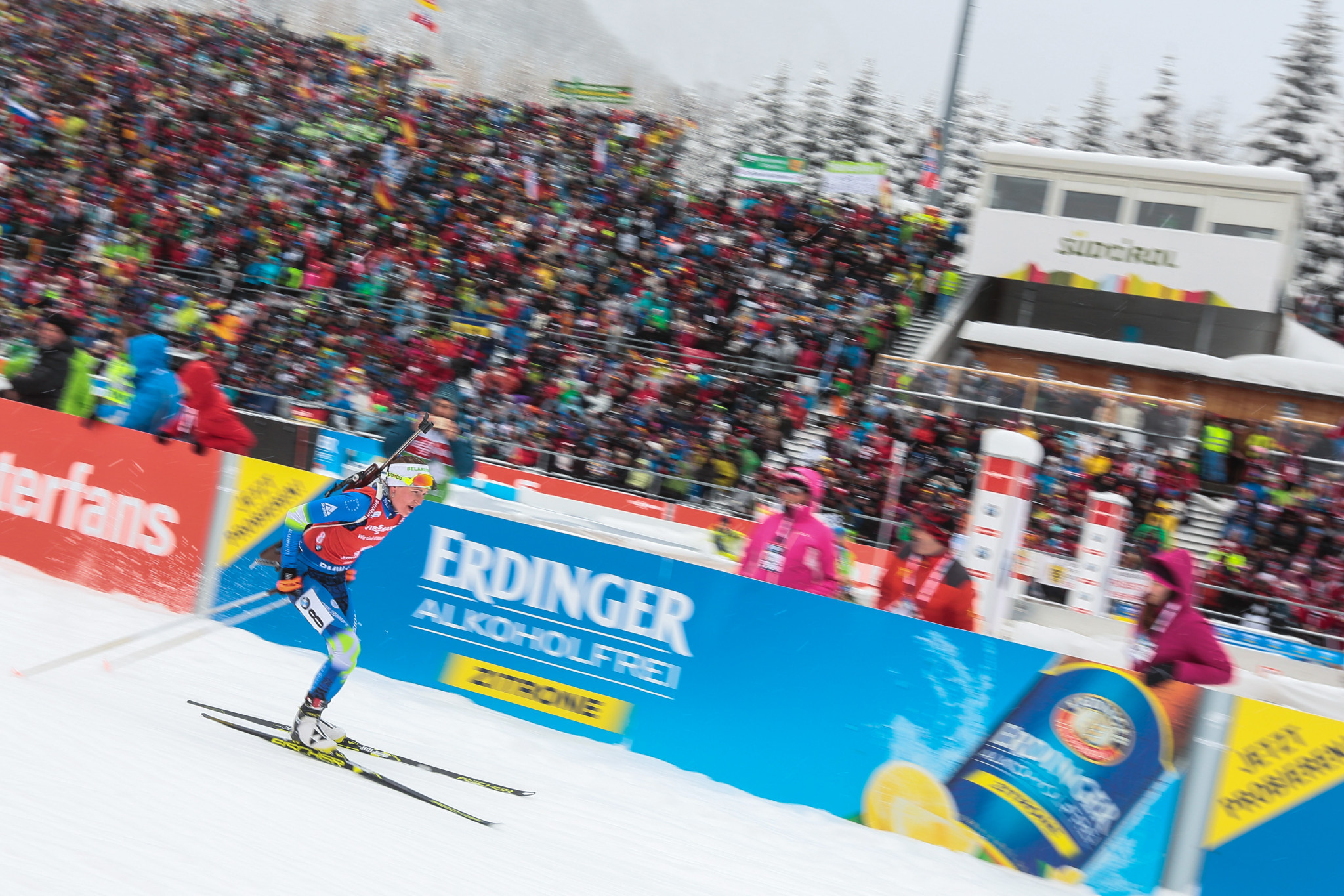 Domracheva and Fourcade clinch mass start titles at IBU World Cup in Antholz