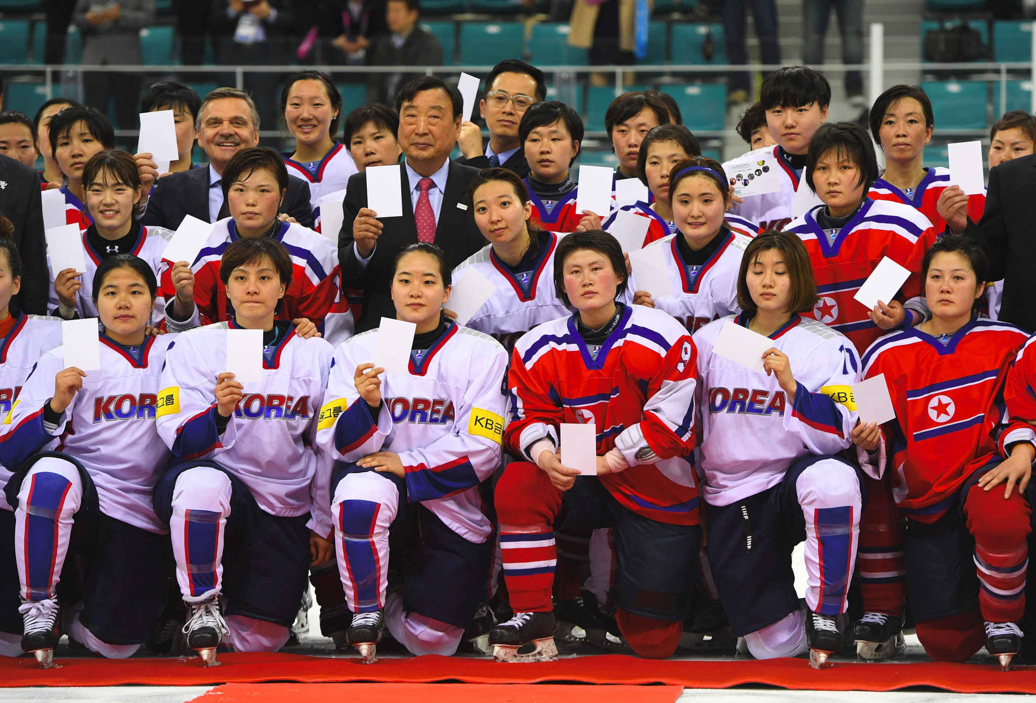 North and South Korean ice hockey players pose together last year after a match at the World Championships ©Getty Images