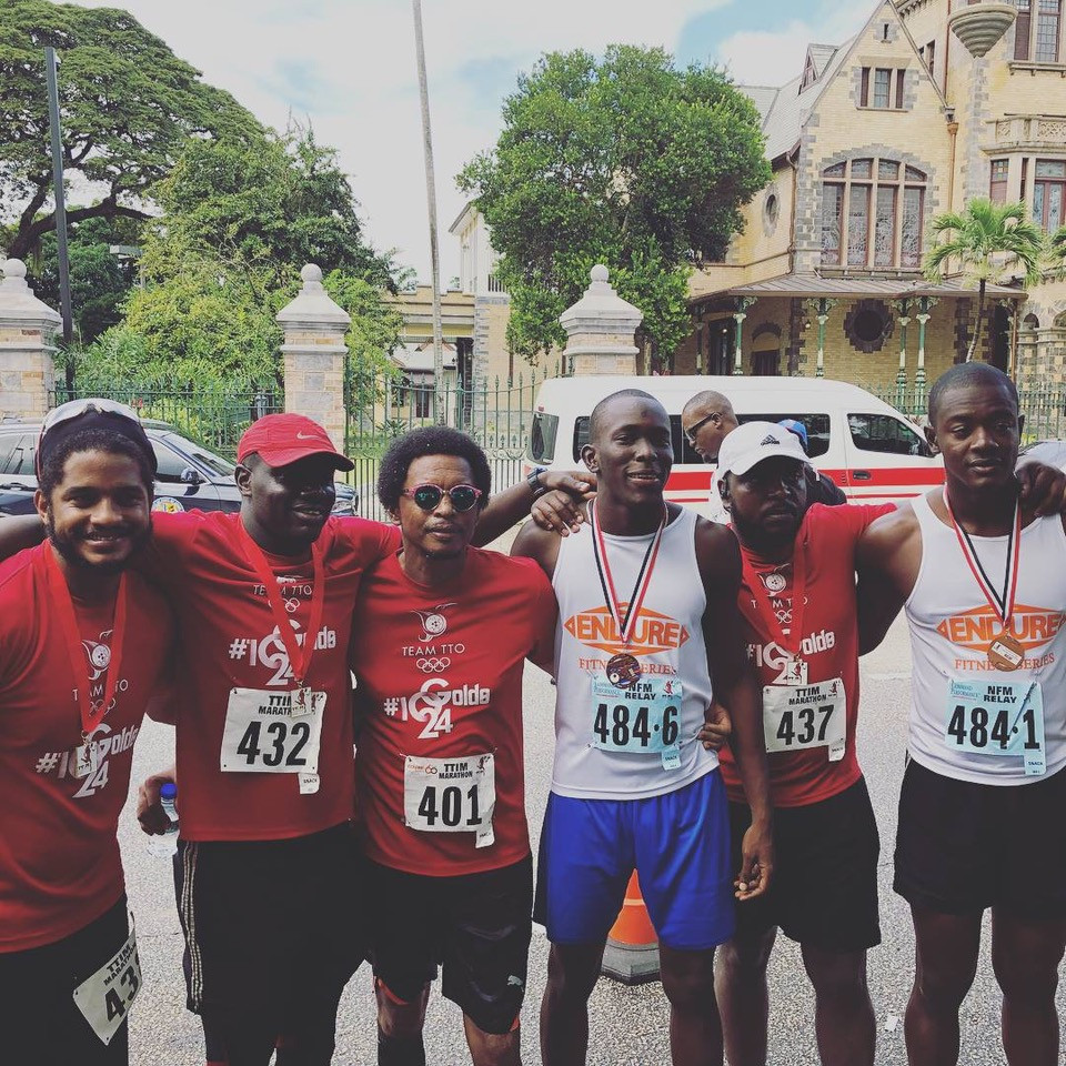 Members of the Trinidad and Tobago Olympic Committee, including President Brian Lewis, second left, after completing the