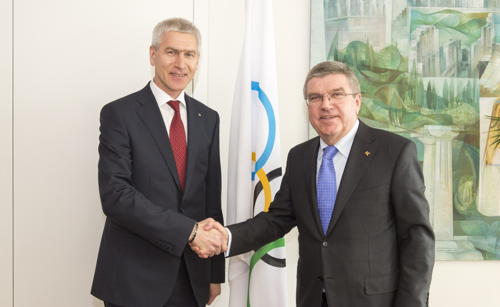 FISU President Oleg Matytsin, left has called Thomas Bach, right, who competed in two Universiade Games, as the
