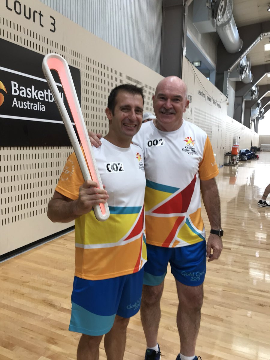 Rob de Castella, left, was the first person to carry the Queen's Baton in Canberra ©Gold Coast 2018