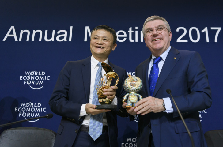 Jack Ma, chief executive of the Chinese technology giant Alibaba, pictured with International Olympic Committee President Thomas Bach at last year's World Economic Summit in Davos, where Alibaba were announced as an IOC TOP sponsor through to 2028 ©Getty Images