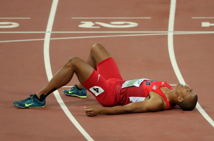 Ashton Eaton of the United States, exhausted after the concluding 1500m, is about to hear he has broken his own world decathlon record. Or maybe already has. ©Getty Images