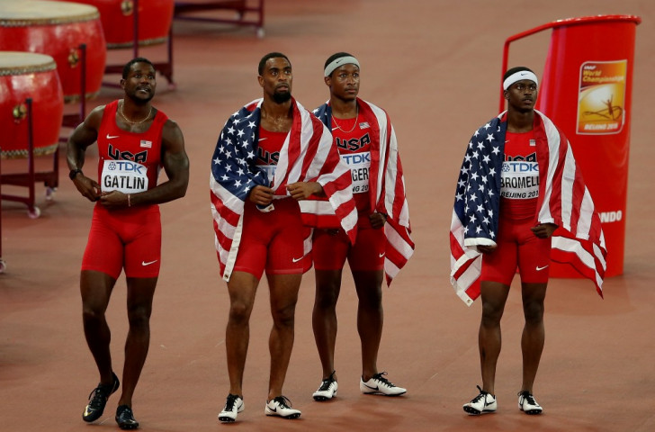 The dollar drops - as the US men's sprint relay team (from left) Justin Gatlin, Tyson Gay, MIke Rodgers and Trayvon Bromell - realise they have been disqualified ©Getty Images