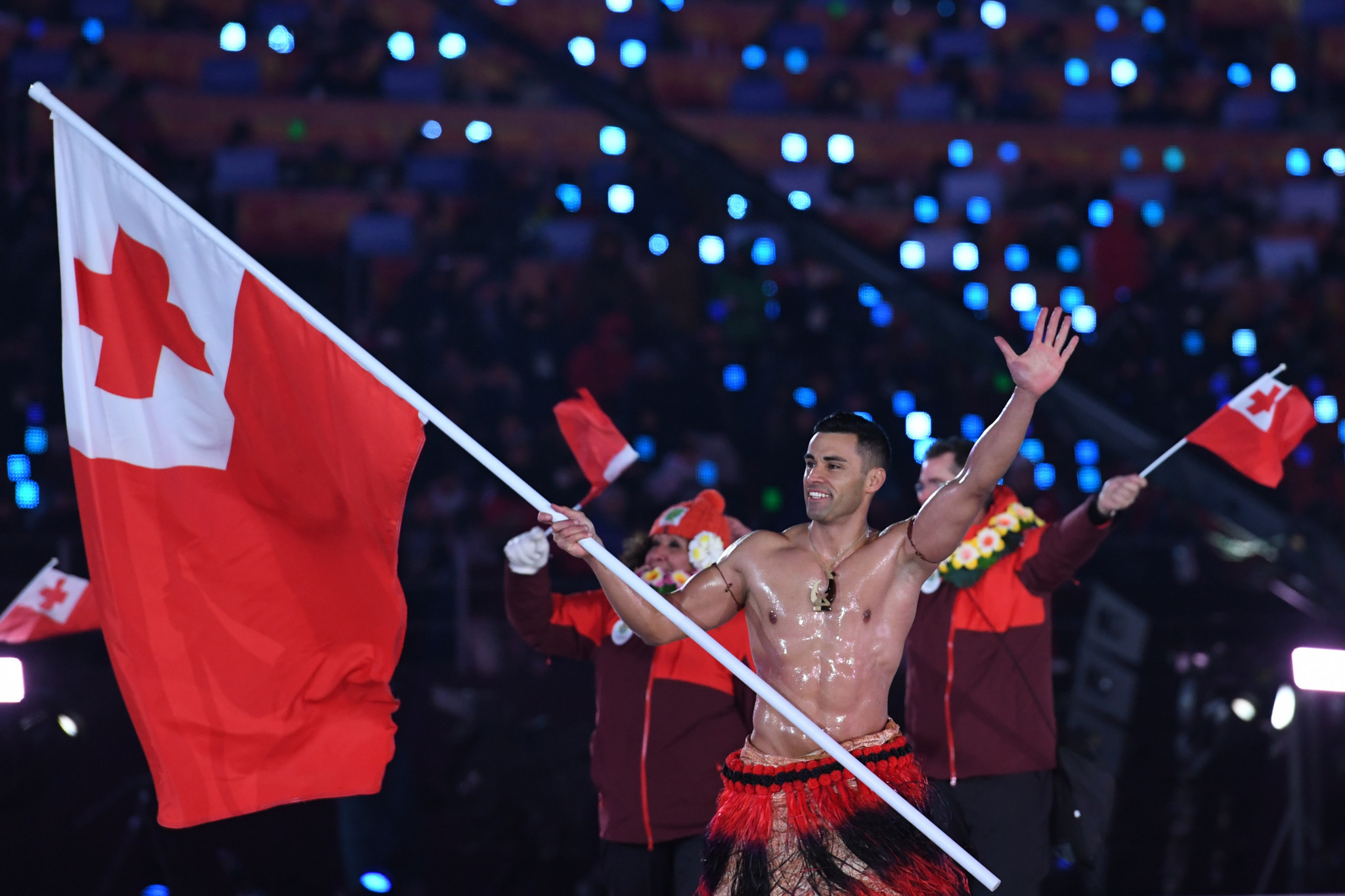 Tongan flagbearer Pita Taufatofua marching topless for the second consecutive Olympic Games Opening Ceremony provided a light-hearted moment ©Getty Images