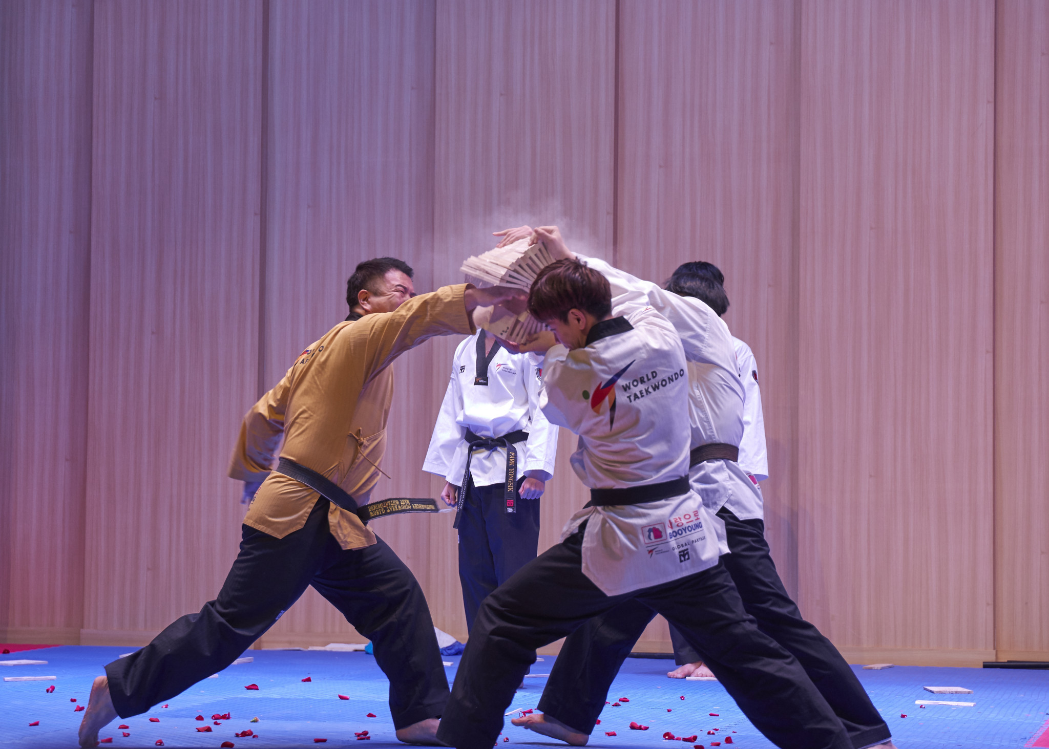 Punching and kicking planks of wood formed a key part of the demonstration ©World Taekwondo
