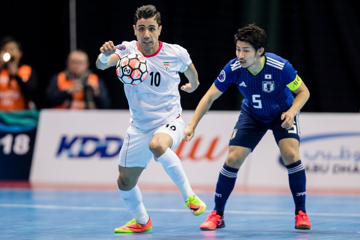Iran's Hossein Tayyebi, left, finished as the tournament's top goalscorer with 14 ©AFC