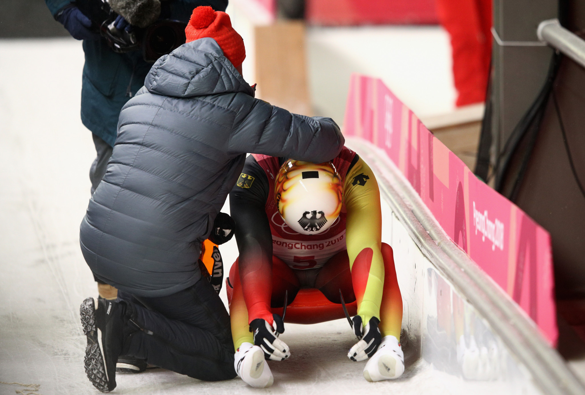 Television cameras picked up the instant emotions of the athletes involved in the dramatic men's luge finale ©Getty Images