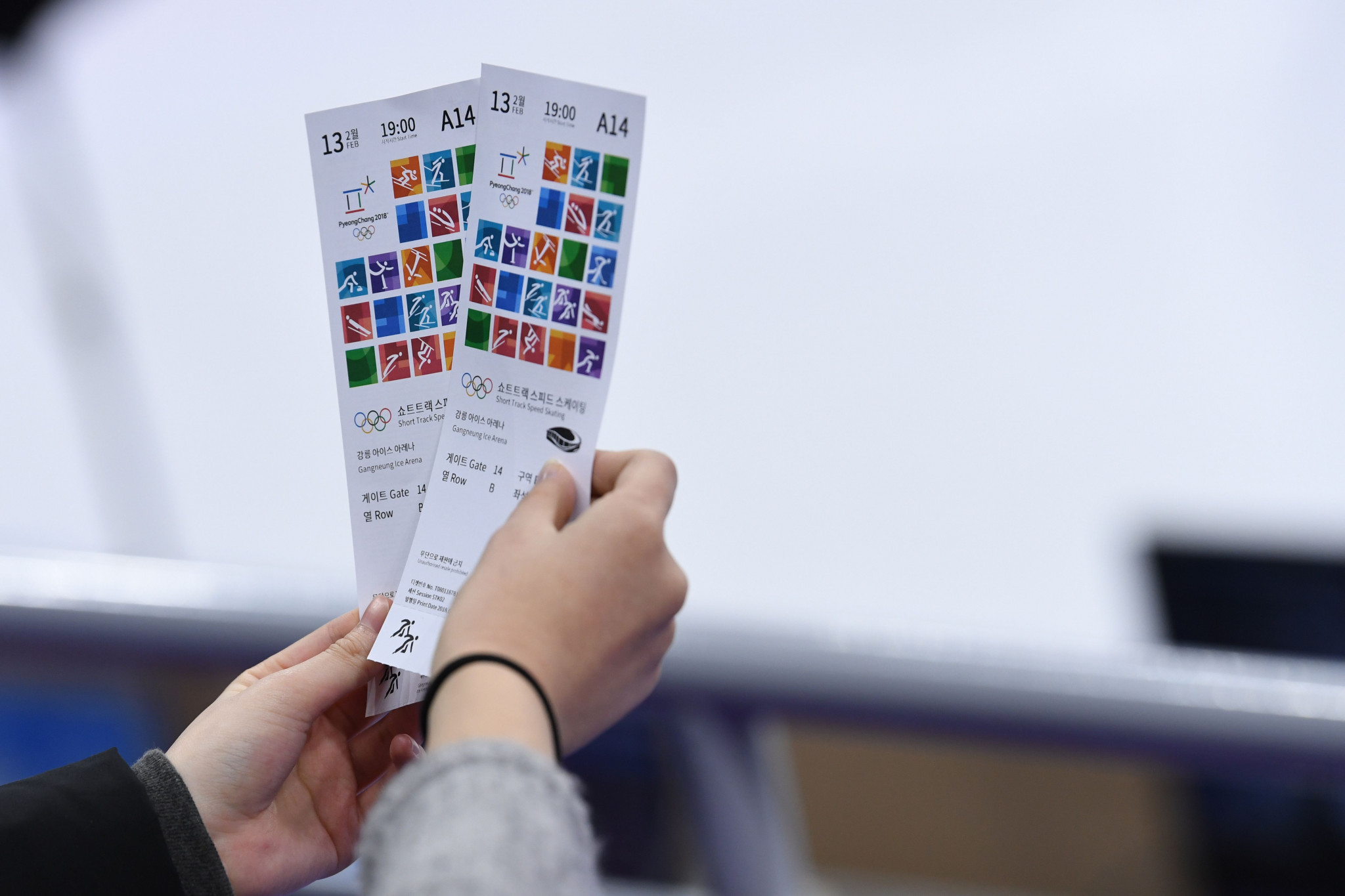 A spectator holds precious tickets at the short-track speed skating ©Getty Images