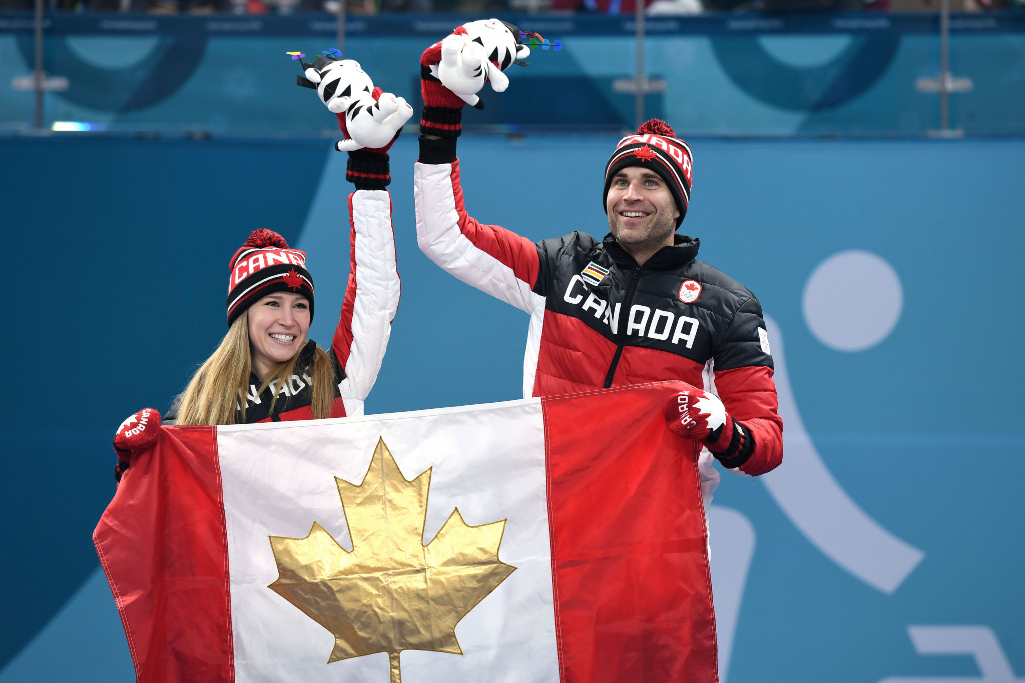 Canada's Kaitlyn Lawes and Canada's John Morris won the mixed doubles curling ©Getty Images