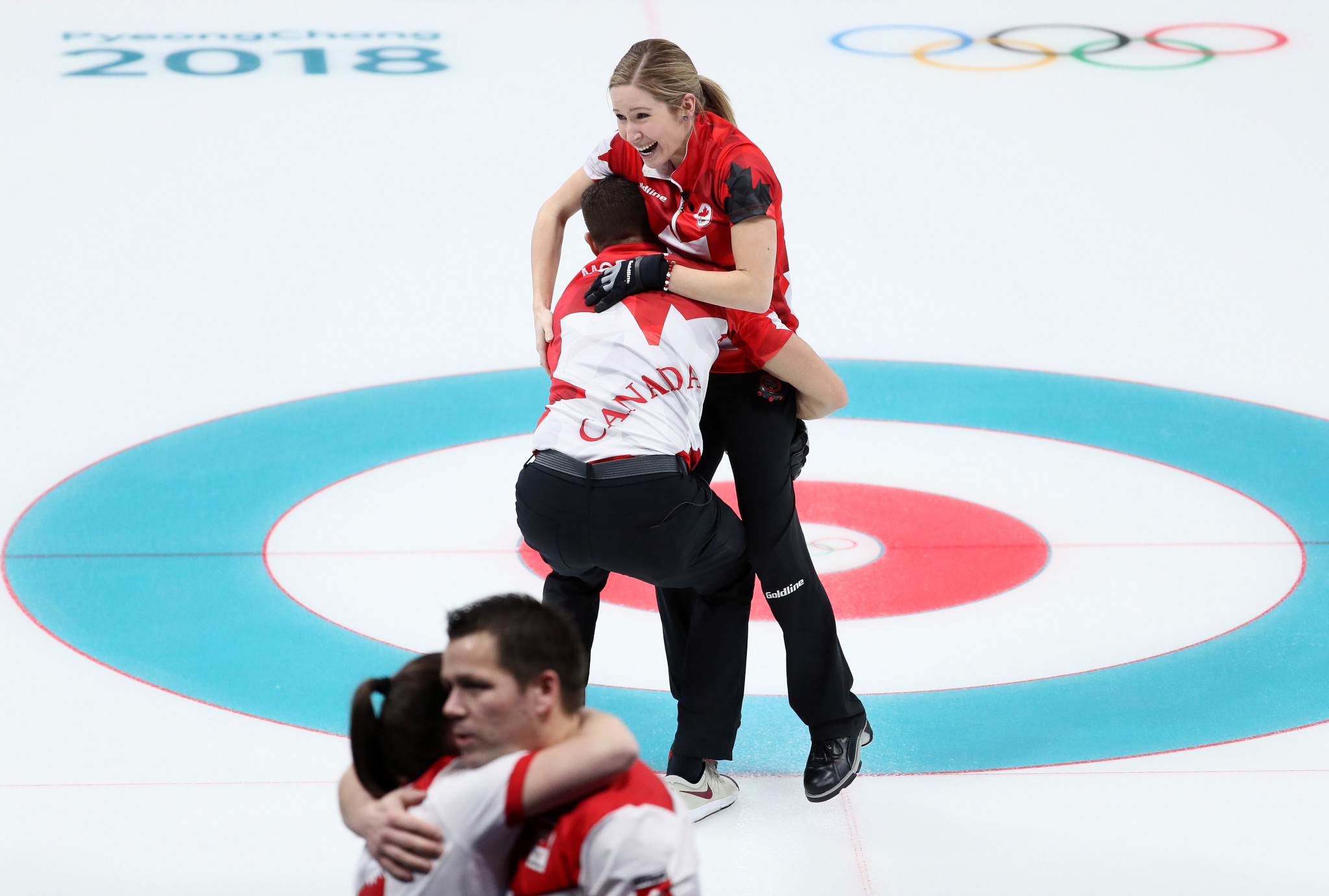 Canada celebrate winning the first ever mixed doubles curling title ©Getty Images