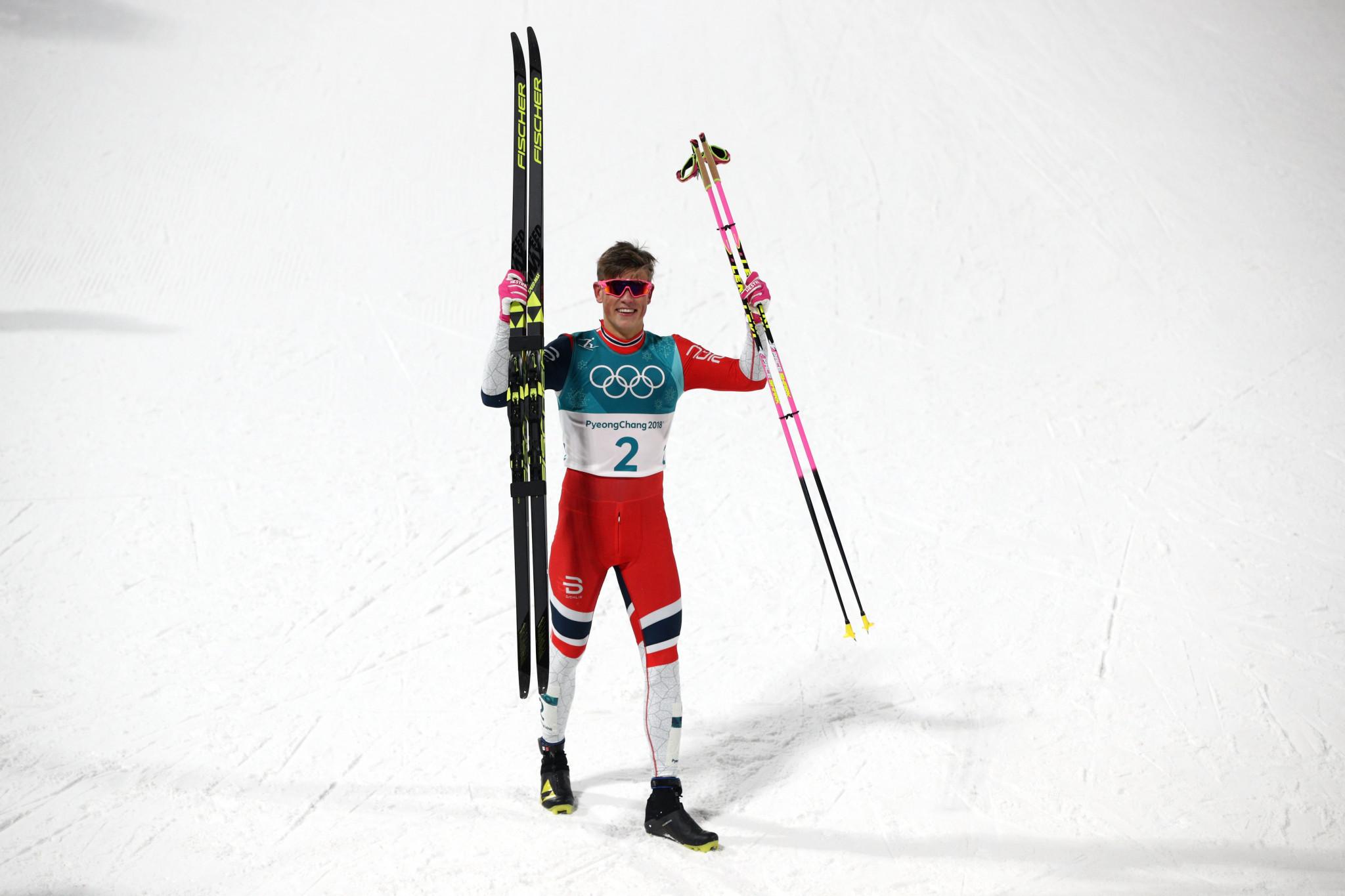 Johannes Hoesflot Klaebo celebrates his men's victory at Pyeongchang 2018 ©Getty Images