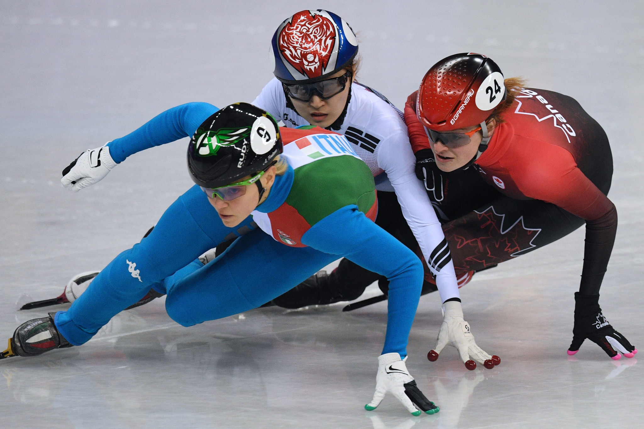 Kim Boutin, right, was promoted to bronze after the disqualification of South Korea's Choi Minjeong, centre ©Getty Images