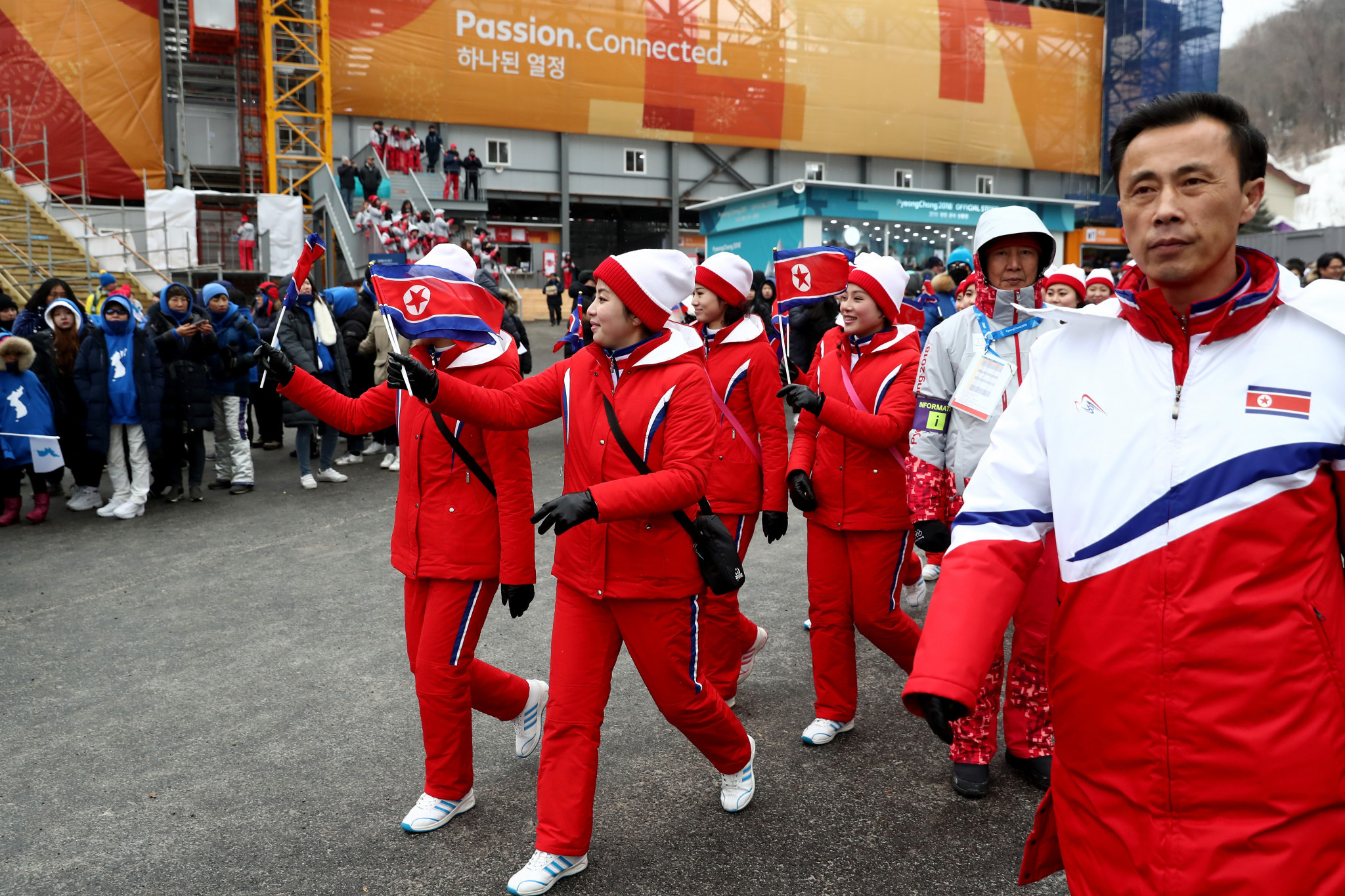 The North Korean cheerleading squad are escorted to venues ©Getty Images