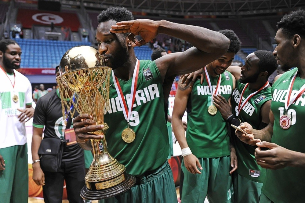 Chamberlain Oguchi holds the AfroBasket trophy after being named as the tournament's MVP ©FIBA