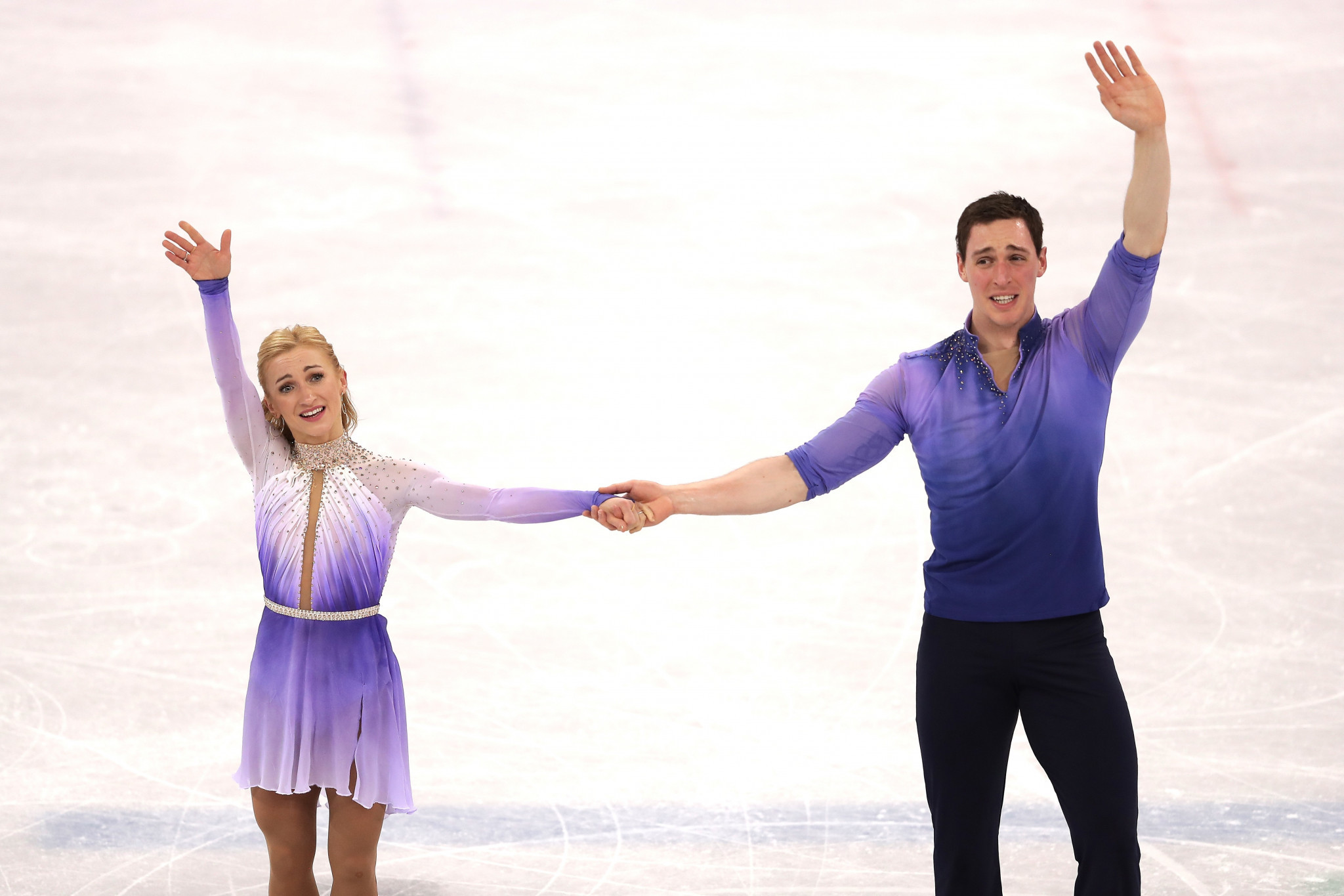 Aliona Savchenko, Bruno Massot use record-setting free skate to win gold