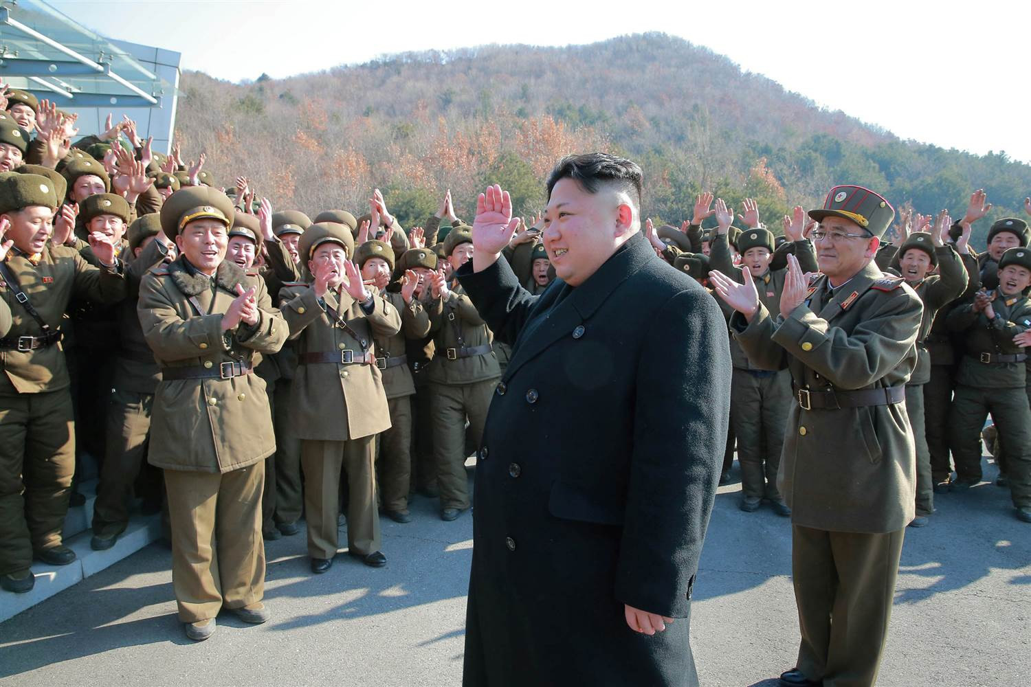 Olympics: The Kim Jong Un impersonator returns, and police escort him out